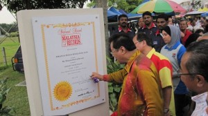Signing longest pasar malam book of record certificate